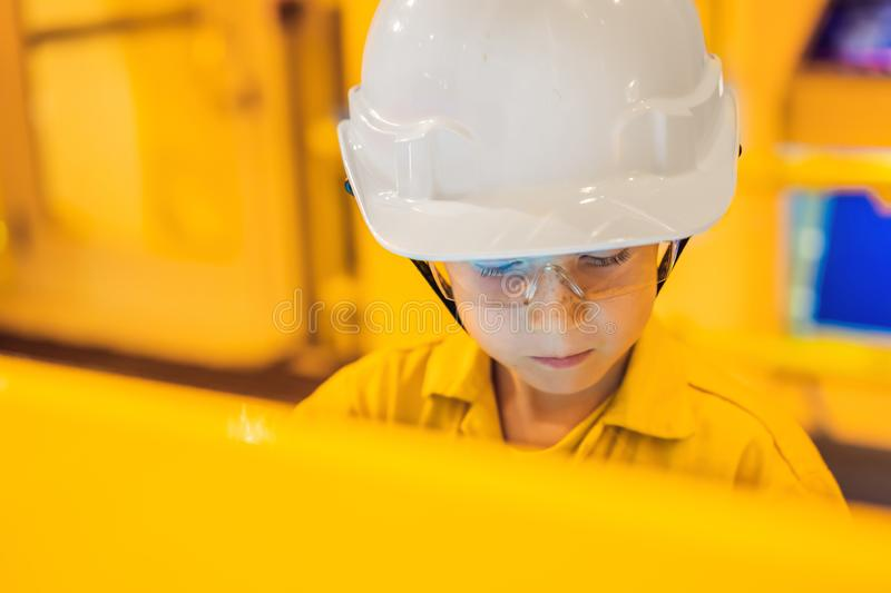 Boy operator recording operation of oil and gas process at oil and rig plant, offshore oil and gas industry, offshore. Oil and rig in the sea, operator monitor royalty free stock photos