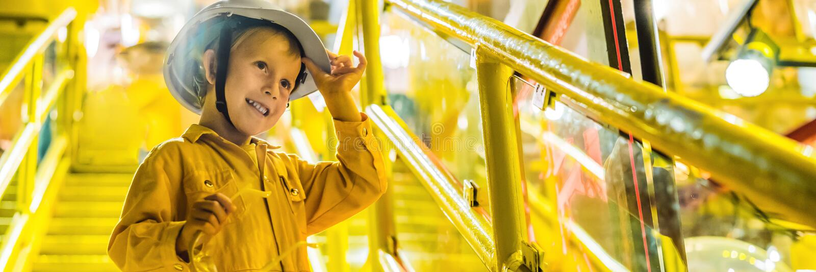 Boy operator recording operation of oil and gas process at oil and rig plant, offshore oil and gas industry, offshore royalty free stock photo