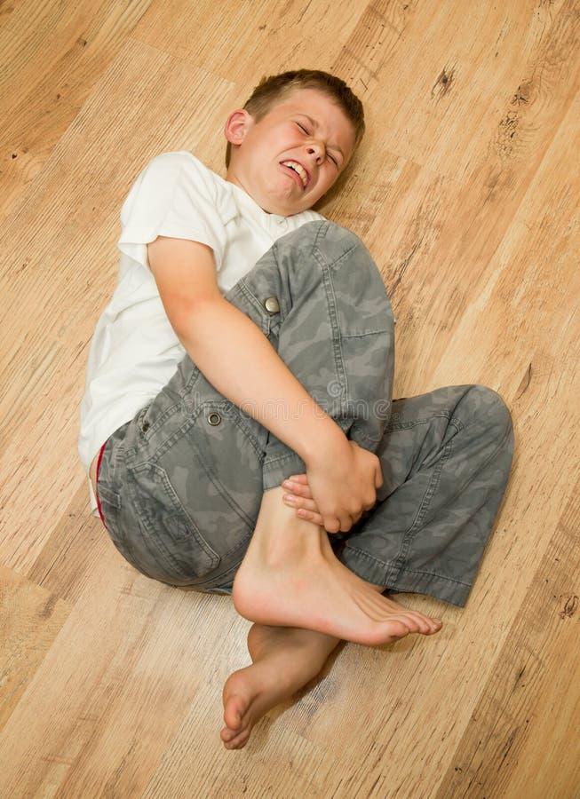 Boy in pain stock photos