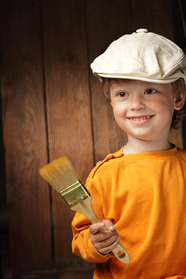 Download Boy with paint brush stock photo. Image of design, brush - 25102542