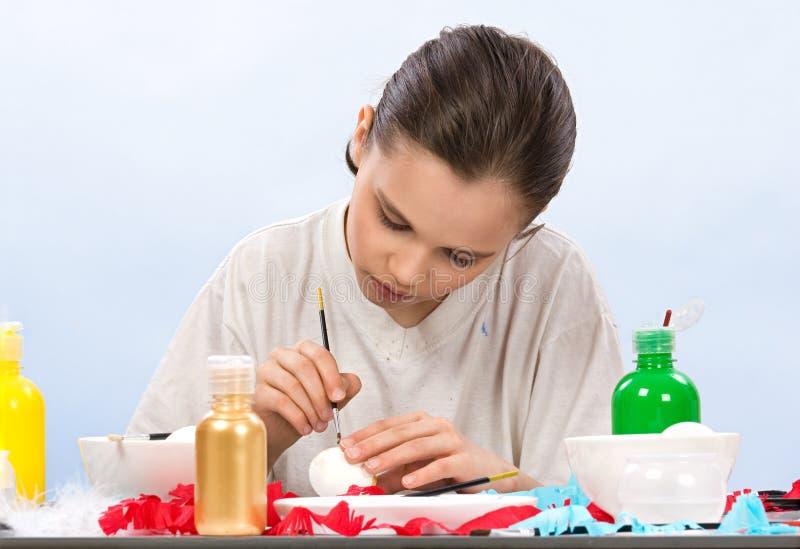 Boy painting egg