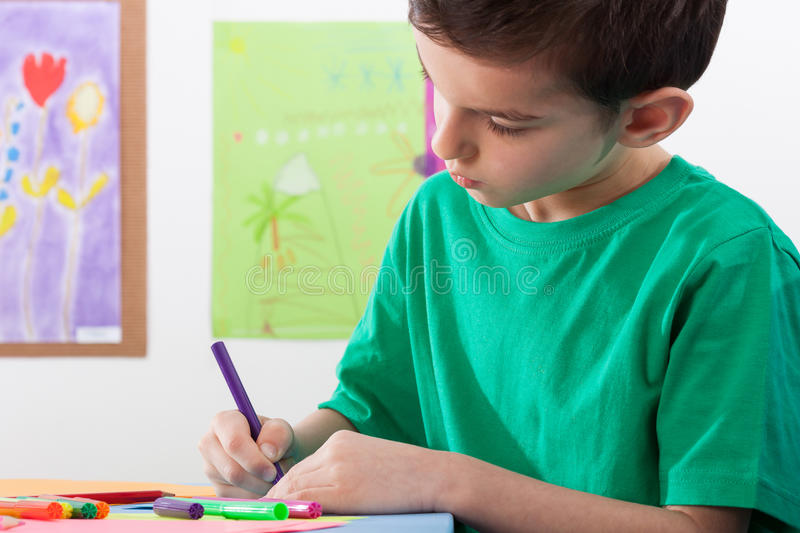 Boy paints on art lessons royalty free stock image