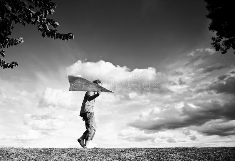 Download Boy With Paper Plane Royalty Free Stock Photography - Image: 23605247