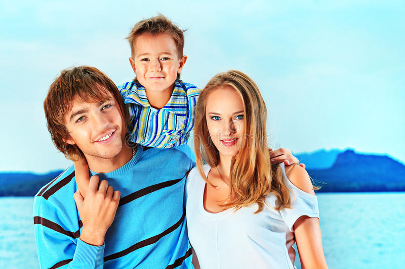 Boy with parents. Portrait of a happy family with little son on vacation royalty free stock photos