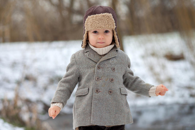 Download Boy In The Park Playing In The Snow Stock Photo - Image of arms, cute: 37013278