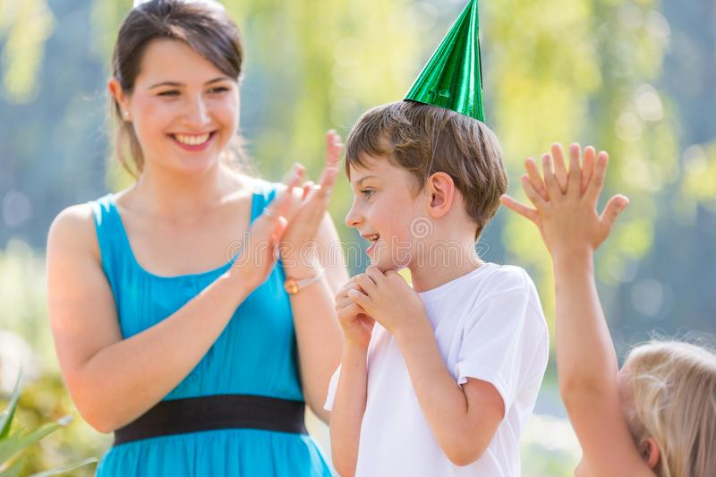 Boy at the party stock images