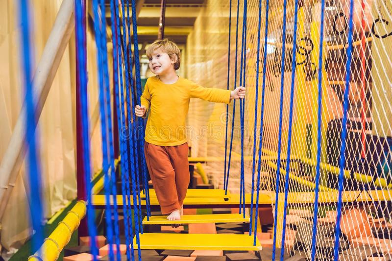The boy passes the obstacle course in the sports club.  royalty free stock images