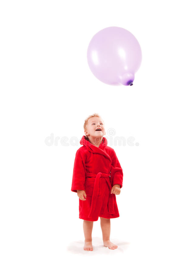 Boy paying with balloon