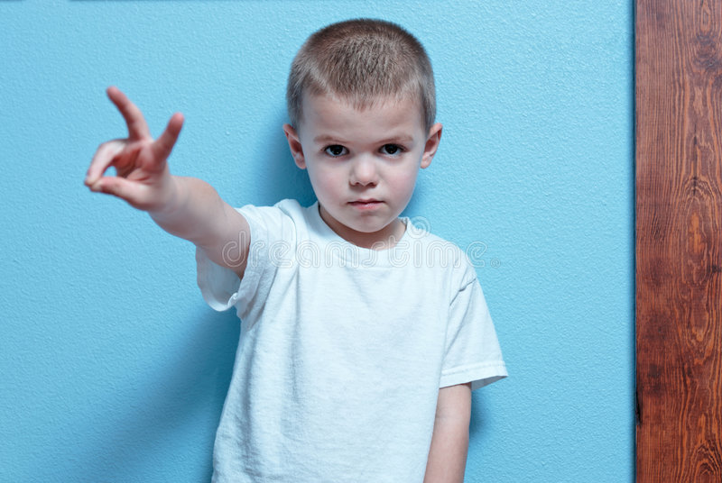 Boy with peace sign stock photo