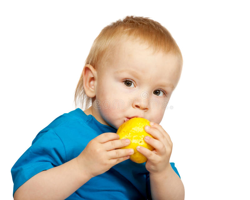 Boy With Pear Stock Photo