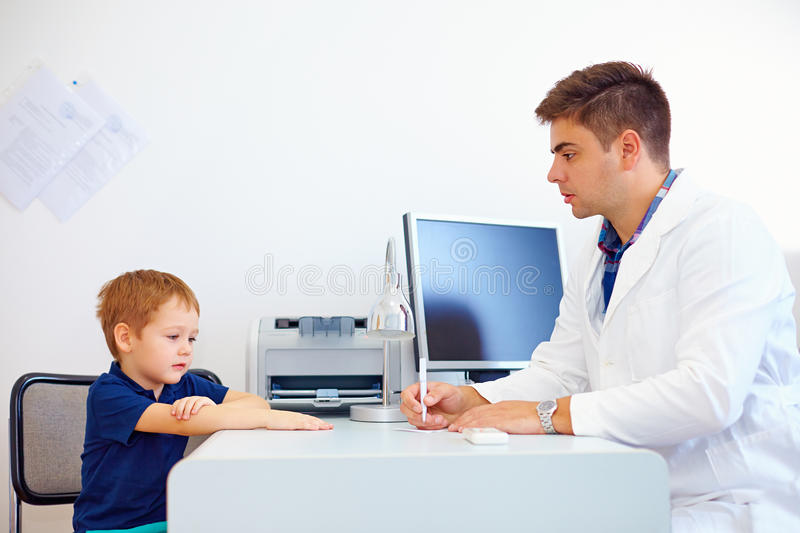 Boy at the pediatrician doctor, psychologist. Therapist stock photo