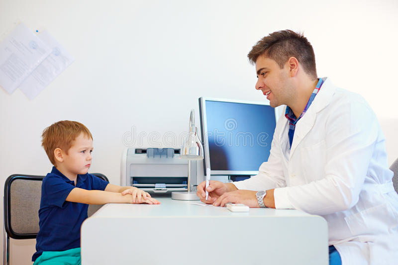 Boy at the pediatrician doctor, psychologist. Therapist stock image