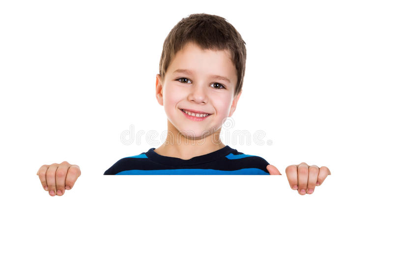 Boy peek out from white banner. Smiling boy with horizontal white empty banner, isolated royalty free stock images