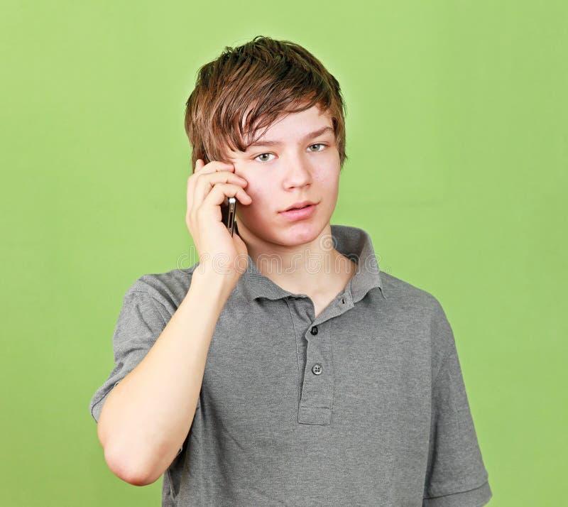 Boy at phone royalty free stock image