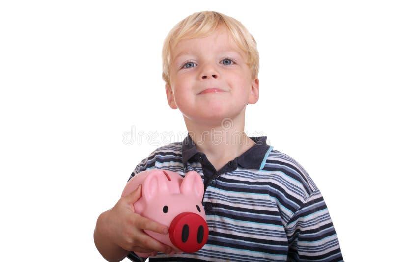 Boy With Piggybank Royalty Free Stock Photos