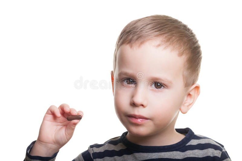 Boy with pill on isolated white. Boy on isolated white asks whenever you took your medicine today stock image