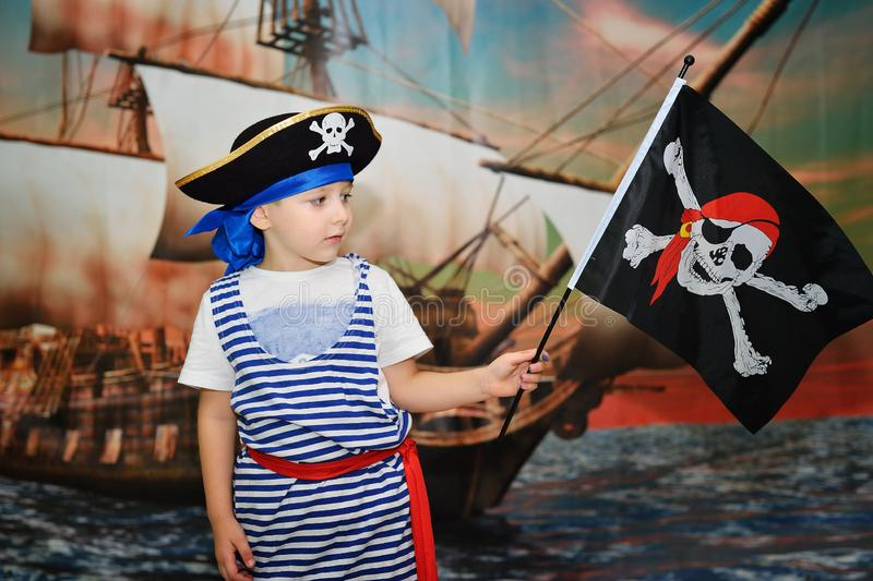 Boy pirate on ship background. Boy pirate with compass on background of ship stock image