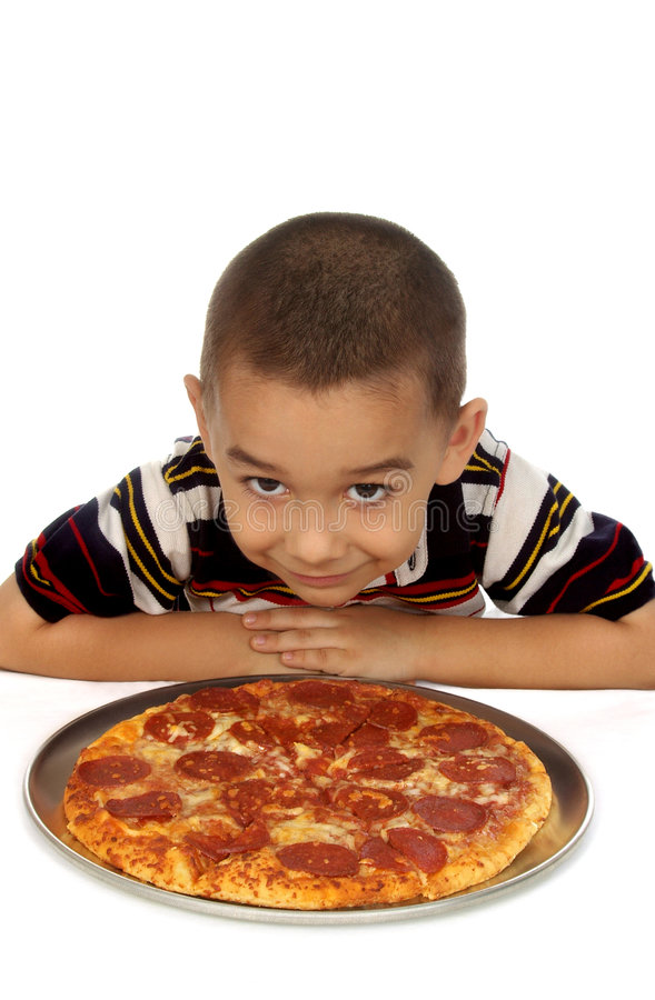 Boy and pizza royalty free stock images