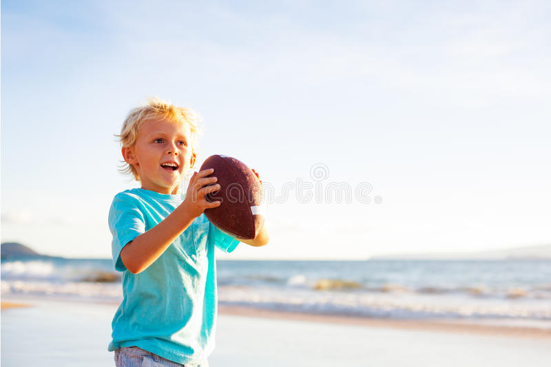 Boy Plaing Catch Throwing Football stock photos