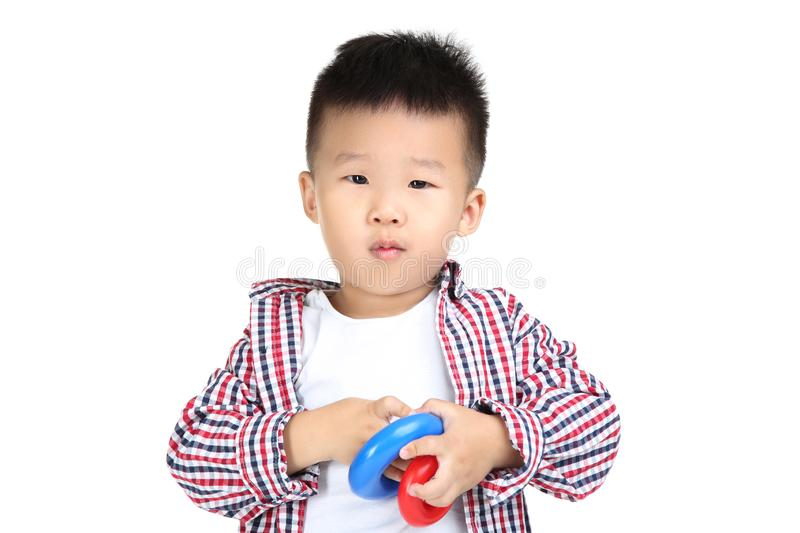 Boy with plastic toys. Beautiful boy with plastic toys on white background stock photos
