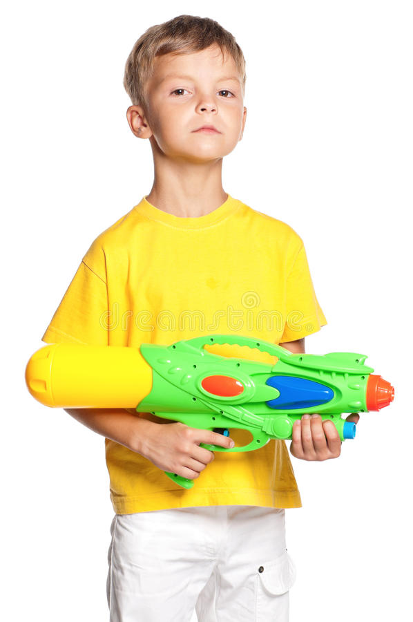 Boy with plastic water gun. Isolated on white background stock photos