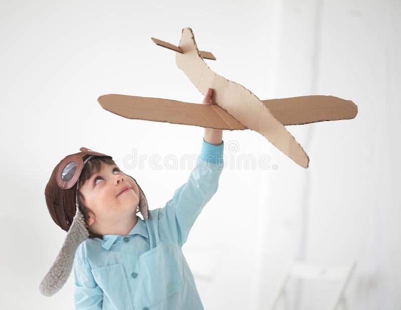 Boy play in airplane royalty free stock image