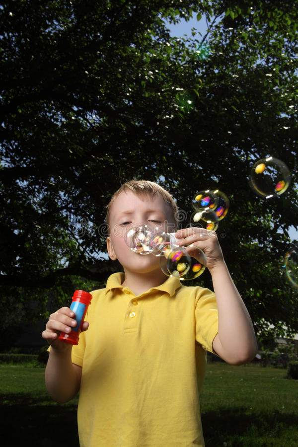 Download Boy play in  bubbles stock photo. Image of blowing, liquid - 29081418