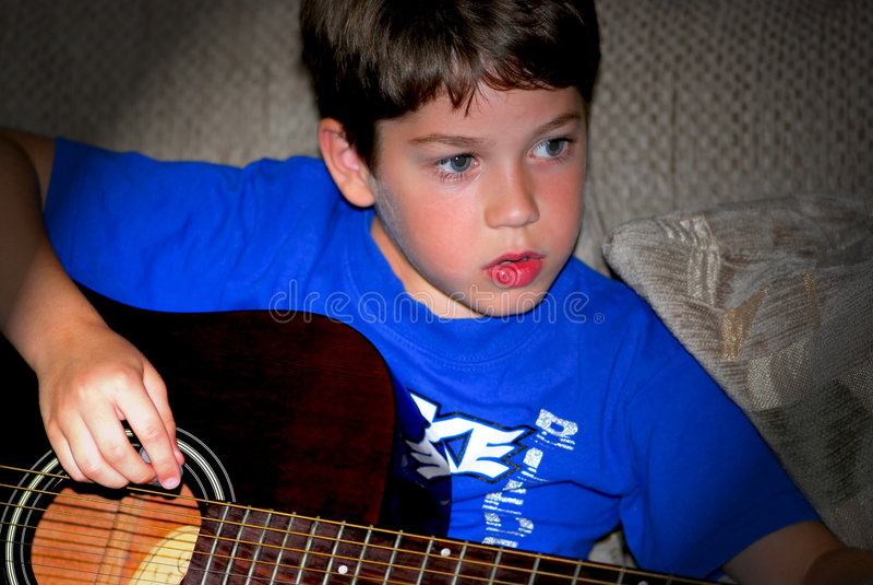 Boy play guitar stock image