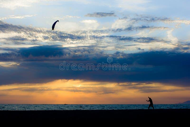 Boy play north wind on the beach royalty free stock photos