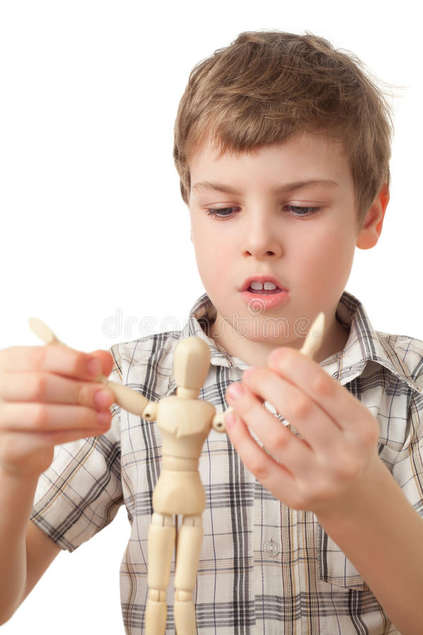 Download Boy Is Played By Wooden Little Manikin Stock Photo - Image of ideas, person: 15690396