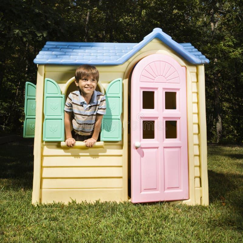 Boy In Playhouse. Stock Photos