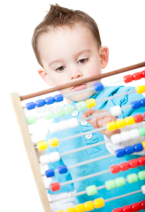 Boy playing with an abacus