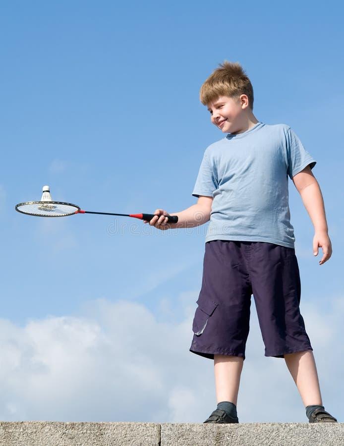 Boy playing badminton royalty free stock photos
