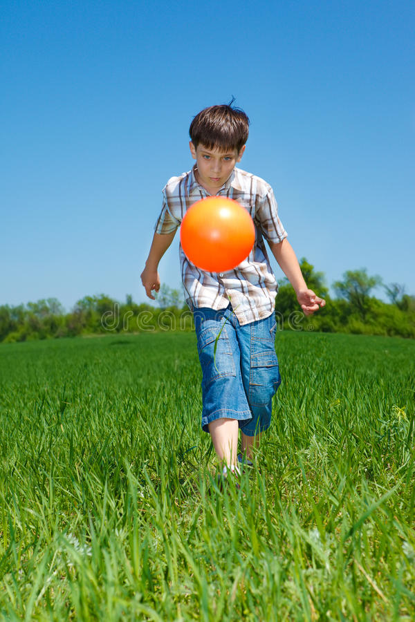 Boy playing with a ball royalty free stock photos