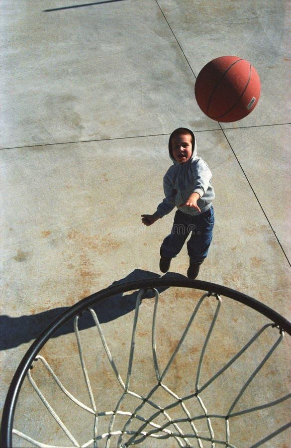 Boy playing basketball stock photos