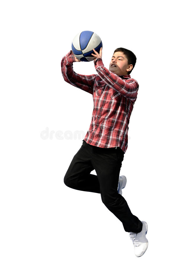 Boy playing basketball. flying and jumping royalty free stock photo
