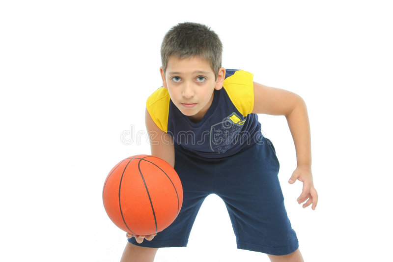 Boy playing basketball isolated. From my sport series royalty free stock photos