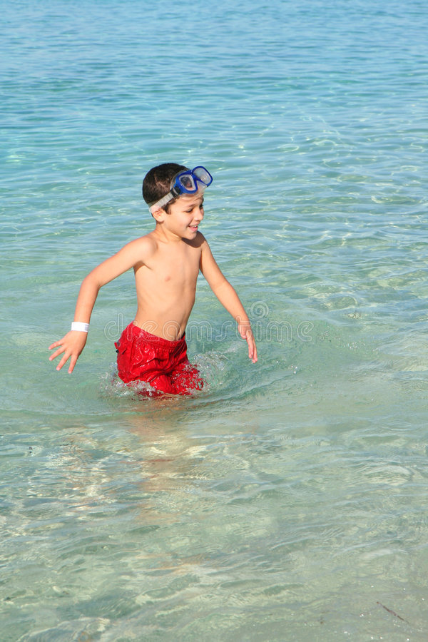 Boy Playing At Beach royalty free stock image