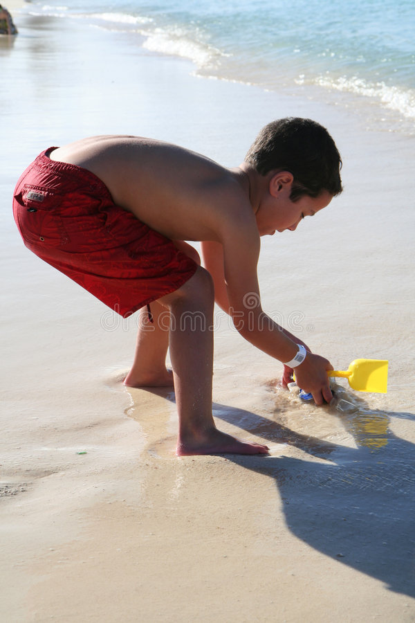 Boy Playing At Beach royalty free stock photos