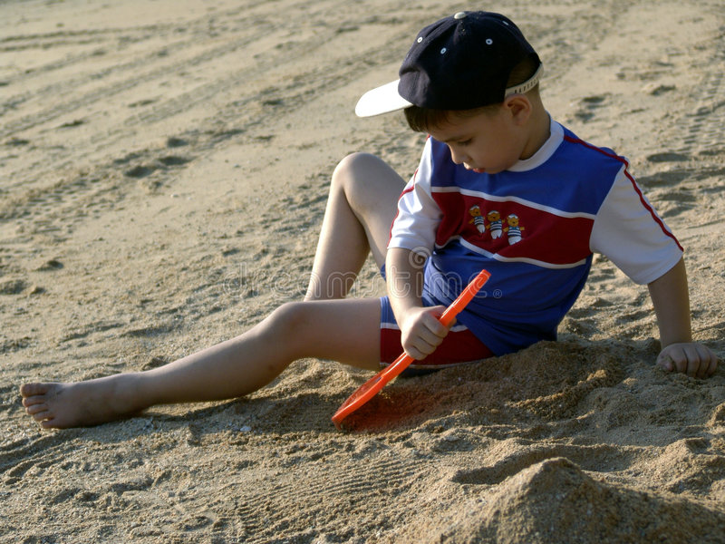Download Boy Playing On The Beach Stock Photo - Image: 5753020