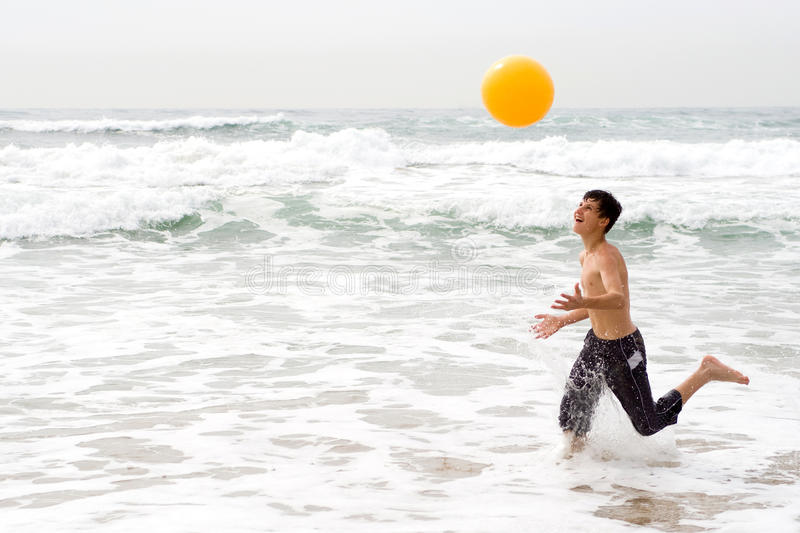 Download Boy playing beach ball stock photo. Image of ocean, ball - 10972606