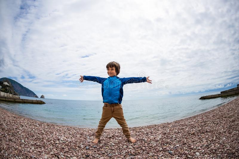 A boy is playing on the beach stock images