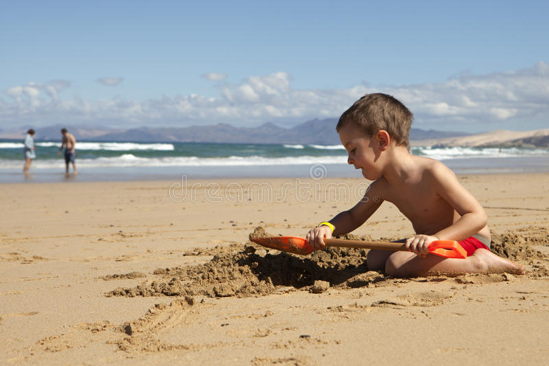 Boy playing on the beach royalty free stock images