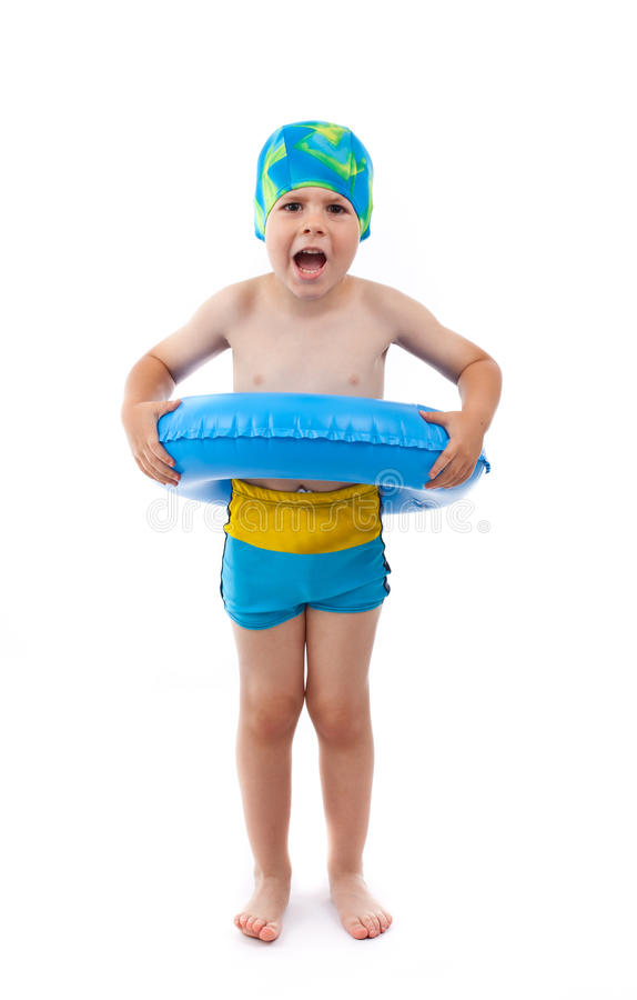 Boy playing with blue life ring. Funny little boy playing with blue life ring in swim caps, isolated in white stock photography