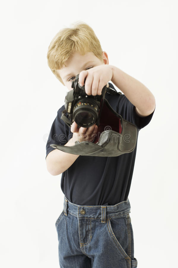 Boy is playing with camera toy. Portrait of a young boy is holding a camera. he has blue eyes and blond hair. the camera is a toy that hang around his neck stock image