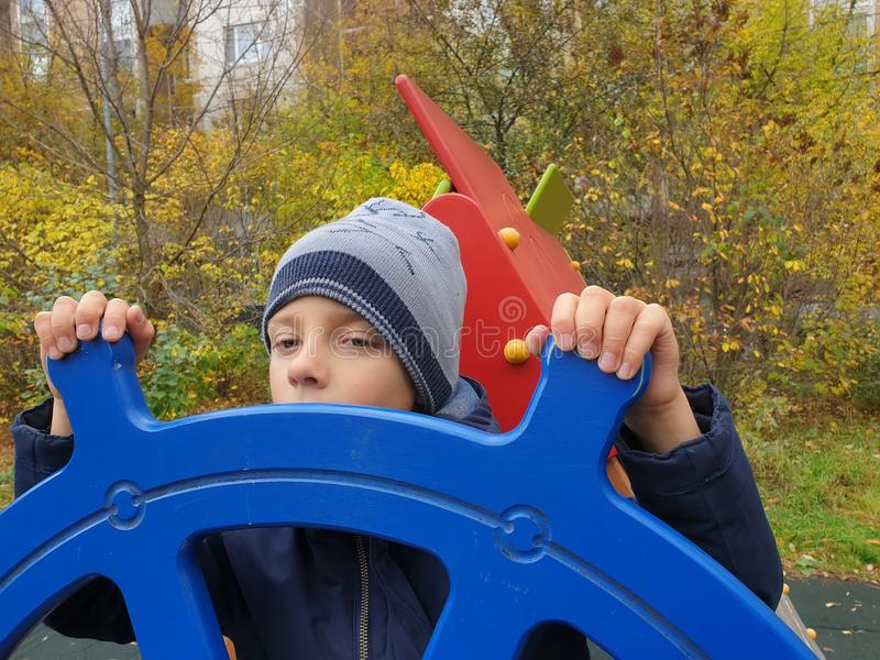 boy playing captain of ship in playground outdoor stock photography
