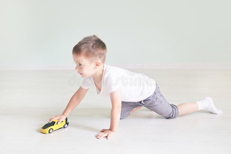 A boy playing with a car remote. In the room stock image