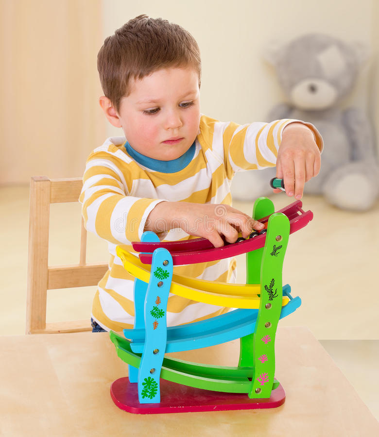 Boy playing with cars. The concept of child development, education, recreation stock photos