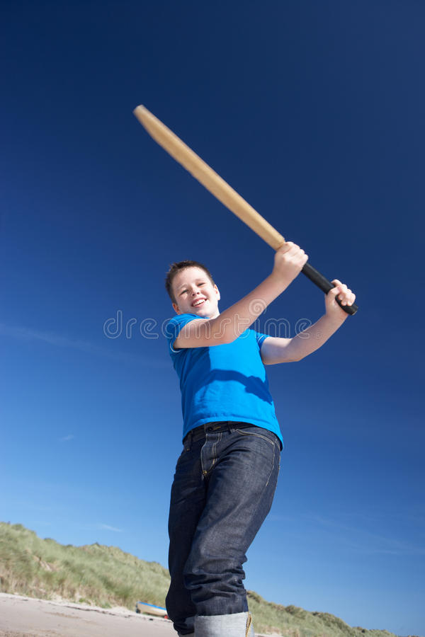 Download Boy Playing Cricket On Beach Stock Photo - Image: 19421552