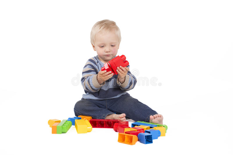 Boy playing with cubes stock photo